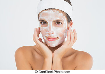 Attractive young woman receiving treatment