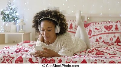 Attractive young woman relaxing at Christmas