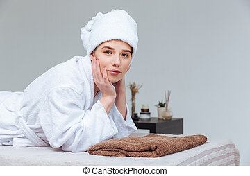Attractive young woman relaxing in spa salon
