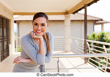 young woman relaxing on balcony
