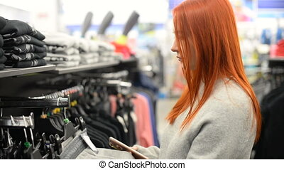 Attractive young woman shopping for clothes