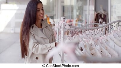 Attractive young woman shopping for clothing