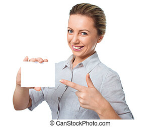 Attractive young woman showing empty blank paper card sign with copy space for text