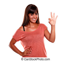 Attractive young woman showing you ok sign