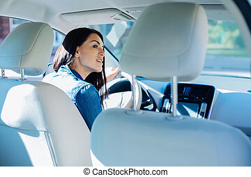 Attractive young woman sitting in the car