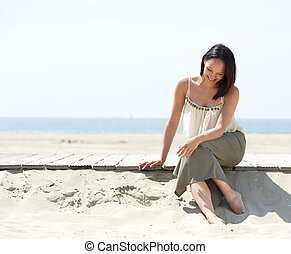 Attractive young woman smiling at the beach