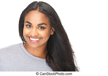 Attractive young woman smiling in studio
