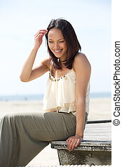 Attractive young woman smiling outdoors
