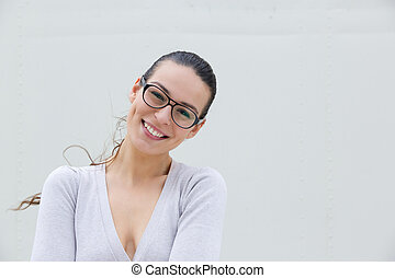 Attractive young woman smiling with glasses