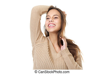 Attractive young woman smiling with hands in hair