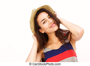 Attractive young woman smiling with hat