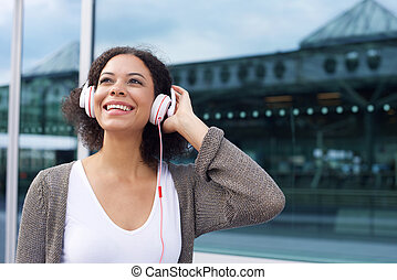Attractive young woman smiling with headphones