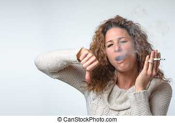 Attractive young woman smoking three cigarettes