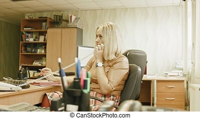 Attractive young woman speaking telephon in office - manager at work