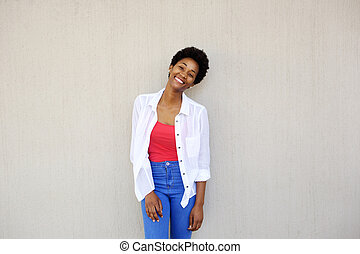 Attractive young woman standing against a wall