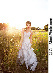 Attractive Young Woman Standing in the Grass