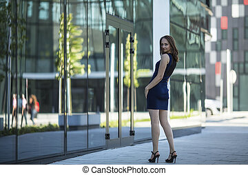 woman standing in the street.