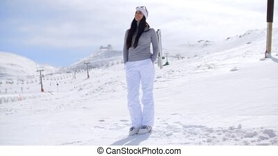 Attractive young woman standing in winter snow