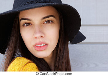 Attractive young woman staring
