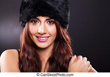 attractive young woman studio portrait on black