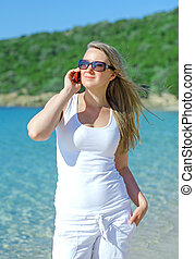 Attractive young woman talking on the phone.