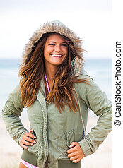 Attractive Young Woman Wearing a Coat