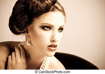 Attractive Young Woman Wearing Pearls