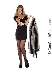 Attractive young woman with a fur coats and money