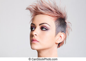Attractive Young Woman with a Punk Hairstyle - Head shot of...