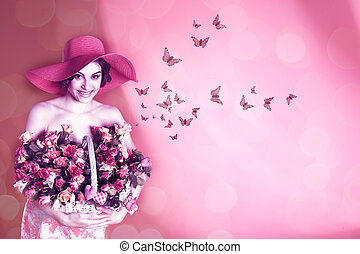 Attractive young woman with bunch of roses