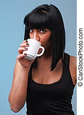 attractive young woman with coffee cup