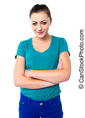 Attractive young woman with folded arms