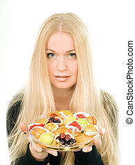 Attractive young woman with fruit candies