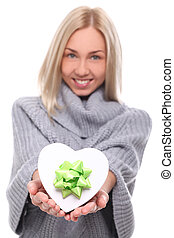 Attractive young woman with gift in hands