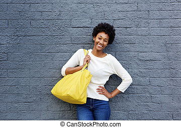 Attractive young woman with handbag