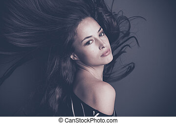attractive young woman with long hair in motion