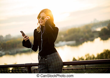 Attractive young woman with mobile phone outdoor