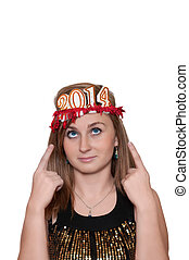 Attractive young woman with new year 2014 on head