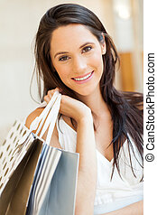 attractive young woman with shopping bags
