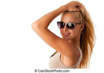 Attractive young woman with sunglasses studio isolated over whit