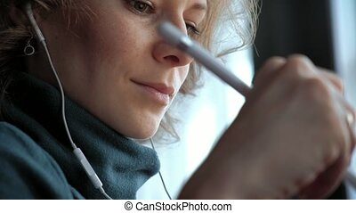 Attractive young woman with tablet in cafe, freelancer...