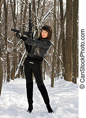 Attractive young woman with weapon