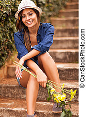 attractive young woman with yellow flowers