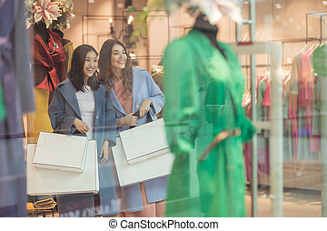 Attractive young women with shopping bags