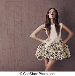 Attractve delicate brunette beauty posing