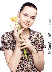 attraktive, junge frau, besitz, a, gelbe tulpe