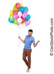 attrayant, tenue, fête, homme, ballons, tas