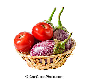 Aubergines and tomatoes in basket isolated on white background