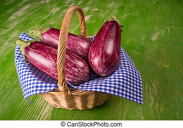 Still life wit aubergines in a traditional basket