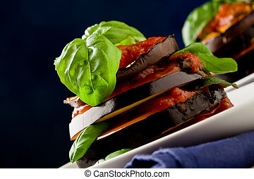 photo of delicious aubergine dish with tomato sauce called parmigiana